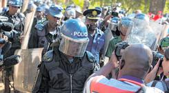 Riot police enter the Bronte hotel, where a press conference by Nelson Chamisa was to take place, in Harare. Photo: AP/Jerome Delay
