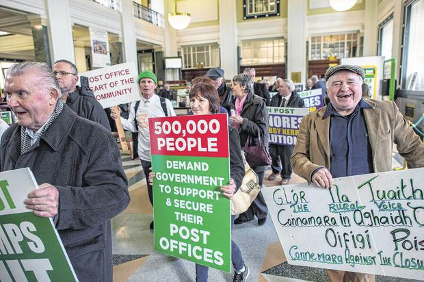 Members of the Irish Postmasters' Union staging a protest about post office closures in the GPO in Dublin last year. Photo: Doug O'Connor