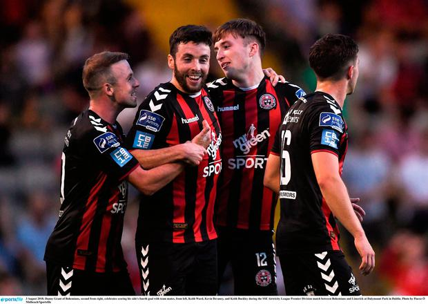 Danny Grant of Bohemians, second from right, celebrates scoring his side's fourth goal