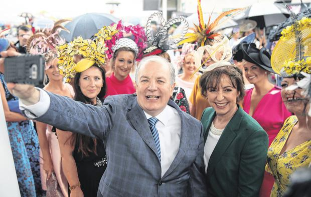 Above: presidential hopeful Gavin Duffy and his wife Orlaith Carmody during Ladies Day at the Galway Races this week. Photo: Mark Condren