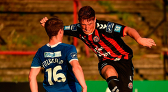 Dan Casey of Bohemians in action against William Fitzgerald of Limerick at Dalymount last night. Photo: Piaras Ó Mídheach/Sportsfile