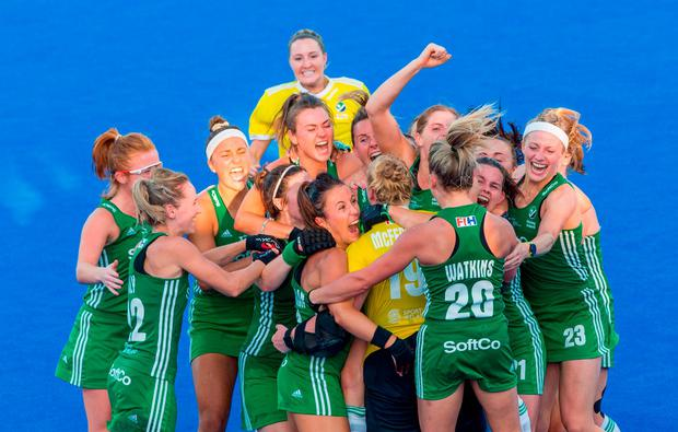 Ireland players celebrate with goalkeeper Ayeisha McFerran after their victory in a penalty shootout during the Women's Hockey World Cup Finals Quarter-Final match between Ireland and India at the Lee Valley Hockey Centre in QE Olympic Park, London, England. Photo by Craig Mercer/Sportsfile