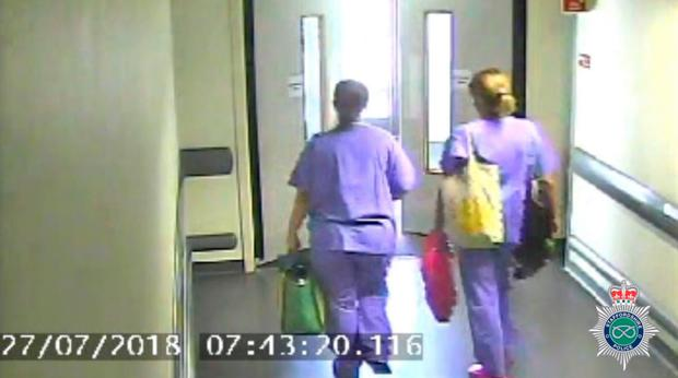 Screengrab from CCTV footage dated 27/07/18 issued by Staffordshire Police which shows missing midwife Samantha Eastwood (left) leaving work at the Royal Stoke University Hospital at 7.43am.
