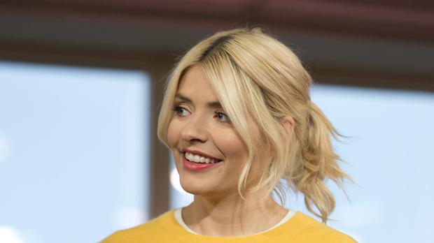 This Morning presenter Holly Willoughby has shared a picture of her an her husband on their wedding anniversary. (Isabel Infantes/PA)