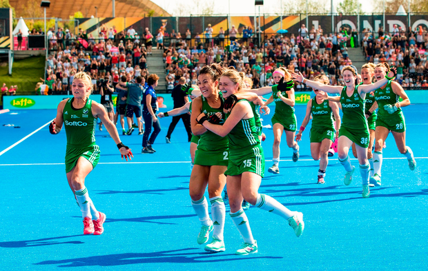 Ireland players, from left, Chloe Watkins, Anna O'Flanagan and Gillian Pinder, celebrate their victory after a sudden death penalty shootout during the Women's Hockey World Cup Finals semi-final match between Ireland and Spain at the Lee Valley Hockey Centre in QE Olympic Park, London, England.