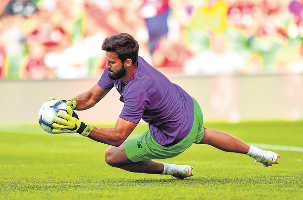 Liverpool's Alisson Becker warms up before the pre-season friendly against Napoli at the Aviva Stadium. Photo: Seb Daly/Sportsfile
