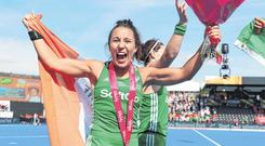 Anna O'Flanagan celebrates victory over Spain in yesterday's World Cup semi-final and, above, the players sing 'Ireland's Call' before the game. Photo: Getty Images
