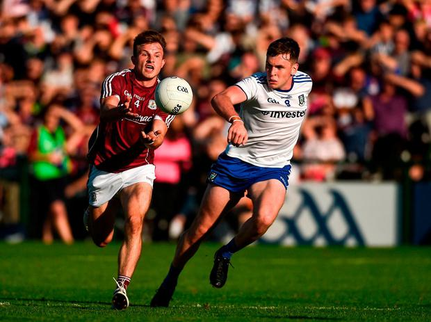 Eoghan Kerin of Galway in action against Niall Kearns of Monaghan. Photo: Diarmuid Greene/Sportsfile