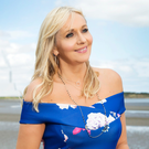 UNFAZED BY LIFE'S ISSUES: Being a mother to eight children has helped Miriam O'Callaghan, who's pictured here on Sandymount Strand in Dublin, adapt well to change. Photo: David Conachy