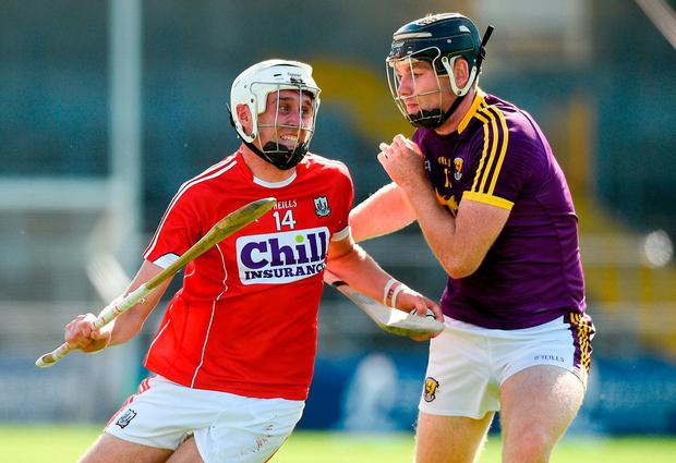 Tim O'Mahony of Cork in action against Eoin Molloy of Wexford. Photo: Matt Browne/Sportsfile