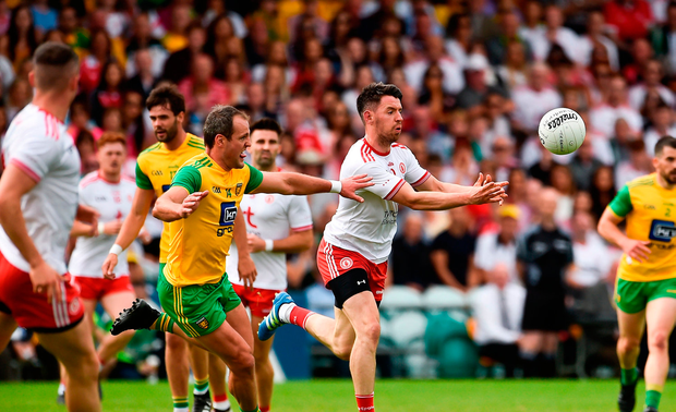 Matthew Donnelly of Tyrone in action against Michael Murphy of Donegal
