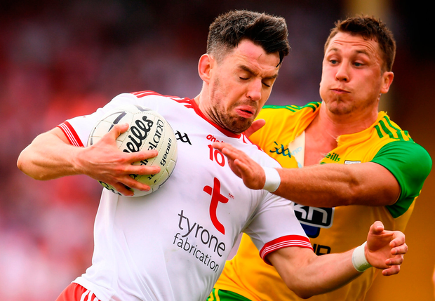 Mattie Donnelly of Tyrone in action against Paul Brennan of Donegal. Photo by Stephen McCarthy/Sportsfile