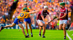 Joe Canning comes under pressure from Clare's Michael O'Malley, with Galway team-mate David Burke (right) in support. Photo by Brendan Moran/Sportsfile