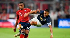 Manchester United's Alexis Sanchez in action with Bayern Munich's Serge Gnabry