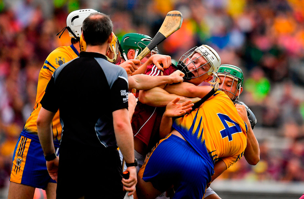 Joe Canning tussles with Clare's Jack Browne. Photo by Brendan Moran/Sportsfile