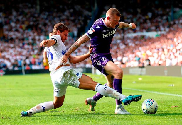 Leeds United's Gaetano Berardi and Stoke City's James McClean. Photo: Nigel French/PA Wire