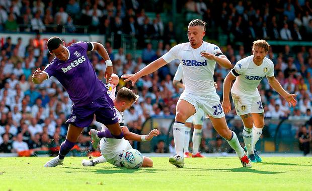 Stoke City's Tom Ince is fouled by Leeds United's Barry Douglas. Photo: Nigel French/PA Wire