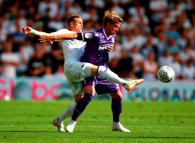 Leeds United's Ezgjan Alioski and Stoke City's Moritz Bauer battle for the ball. Photo: Nigel French/PA Wire