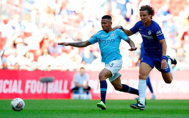 Chelsea's David Luiz in action with Manchester City's Gabriel Jesus. Photo: Phil Noble/Reuters