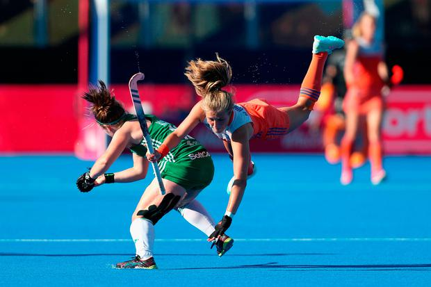 Shirley McCay stops Holland's Xan de Waard in her tracks during the World Cup final in London. Photo by Christopher Lee/Getty Images