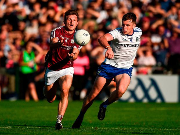 Galway's Eoghan Kerin in action against Monaghan's Niall Kearns. Photo: Diarmuid Greene/Sportsfile