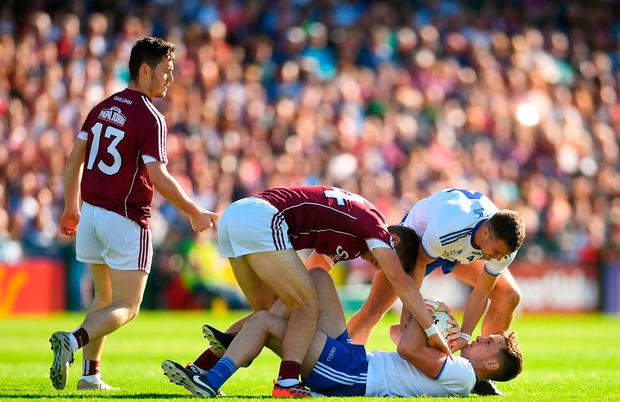 Galway full-forward Damien Comer in action against Monaghan duo Niall Kearns (below) and Ryan Wylie. Photo: Ramsey Cardy/Sportsfile
