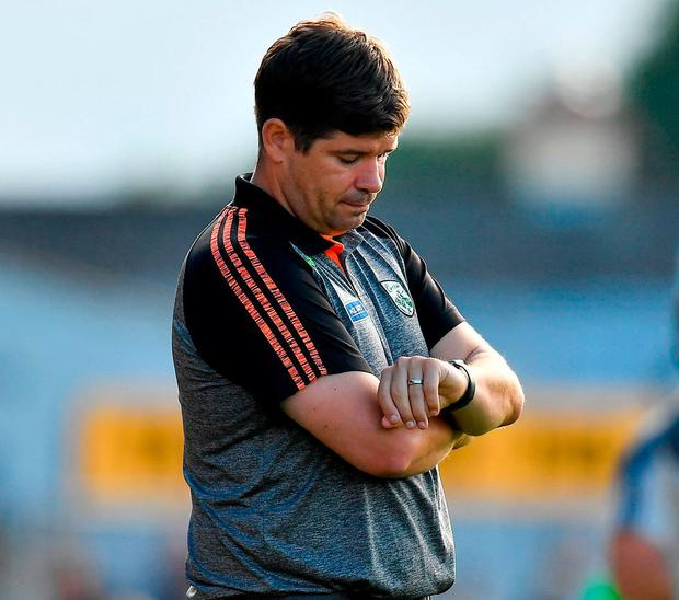 Kerry manager Eamonn Fitzmaurice checks his watch during the closing stages in Killarney. Photo: Brendan Moran/Sportsfile