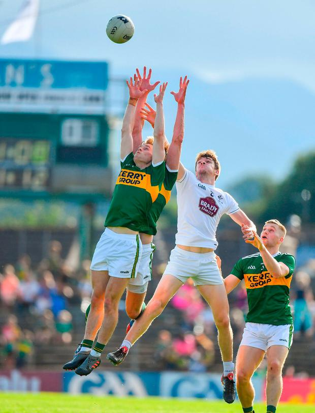 Kerry's Gavin White and David Moran contest a high ball with Kildare's Kevin Feely. Photo: Brendan Moran/Sportsfile