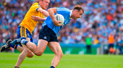 Cormac Costello of Dublin in action against Ross Timothy of Roscommon