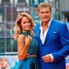 BERLIN, GERMANY - MAY 30: David Hasselhoff (R) and his partner Hayley Roberts pose at the 'Baywatch' Photo Call at Sony Centre on May 30, 2017 in Berlin, Germany. (Photo by Andreas Rentz/Getty Images for Paramount Pictures)