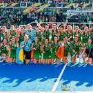 The Ireland team and coaching staff celebrate with their medals after the Women's Hockey World Cup Final match between Ireland and Netherlands at the Lee Valley Hockey Centre in QE Olympic Park, London, England. Photo by Craig Mercer/Sportsfile