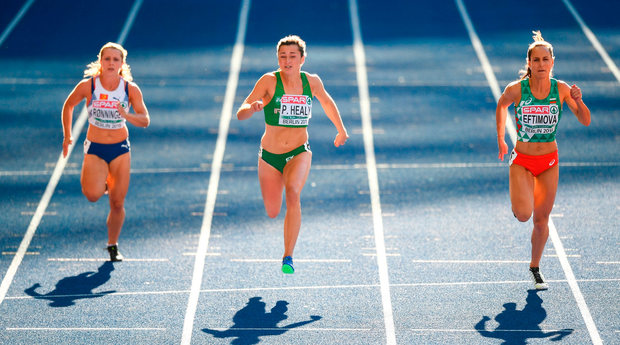 Phil Healy of Ireland, centre, competing in the Women's 100m heats during Day Q of the 2018 European Athletics Championships at Berlin in Germany.