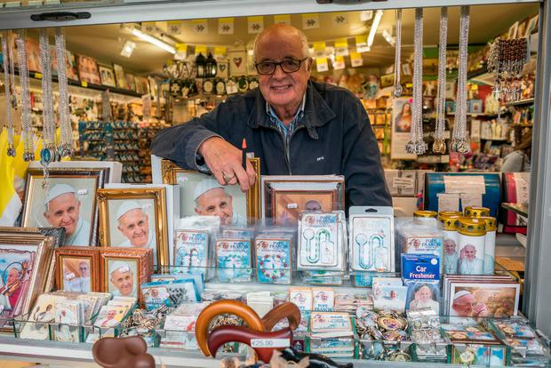 Left: Shopkeeper Bernie Byrne is doing a roaring trade in papal memorabilia at his shop in Knock. Photos: Keith Heneghan