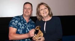 Filmmaker John Butler presents Mary McAleese with the Vanguard Award from Gaze LGBT Film Festival in Dublin last night