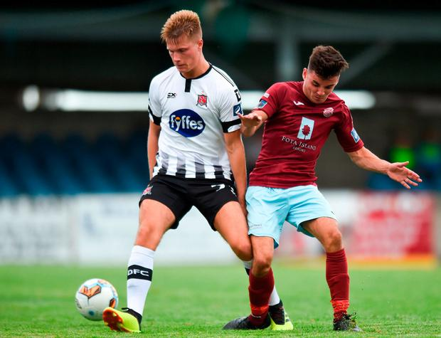 Daniel Cleary of Dundalk in action against Stephen Christopher of Cobh Ramblers. Photo: Ben McShane/Sportsfile