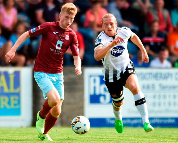 David Hurley of Cobh Ramblers in action against John Mountney of Dundalk. Photo: Ben McShane/Sportsfile