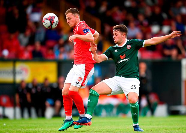 Lewis Morrison of Sligo Rovers in action against Ben Doherty of Derry City. Photo: Stephen McCarthy/Sportsfile