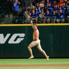 SEATTLE, WA - AUGUST 04: (EDITORS NOTE: Image contains nudity.) A streaker runs across right field during the ninth inning of the game between the Toronto Blue Jays and Seattle Mariners at Safeco Field on August 4, 2018 in Seattle, Washington. (Photo by Lindsey Wasson/Getty Images)