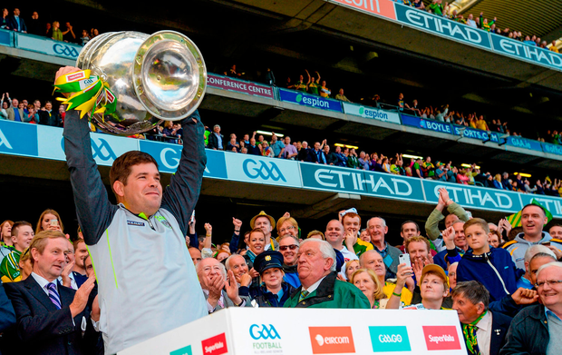 In happier times: Eamonn Fitzmaurice lifts the Sam Maguire in 2014, his second year in charge of Kerry. Photo: Sportsfile
