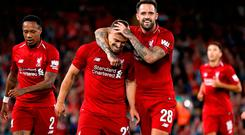 Danny Ings celebrates with Xherdan Shaqiri after Liverpool,s third goal third goal, scored by Daniel Sturridge, against Torino at Anfield. Photo: Carl Recine/Reuters