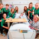 The World Cup heroes with Eadba Ni Chathasaigh and her mother Lisa Ni Larliathe and (left) Nicci Daly and Nicola Evans with Dawn Fahy (4) and Holly Carroll (3)