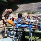 A person is transported to a helicopter after eating contaminated food at a funeral in the Peruvian Andes, authorities said on Tuesday, in Ayacucho, Peru Photo courtesy of Agencia Andina/Coen Handout via REUTERS