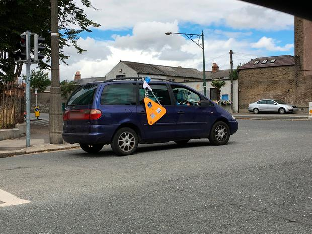 The car was spotted driving around Dublin with a clamp seemingly tied to the roof. Photo: Damien Eagers
