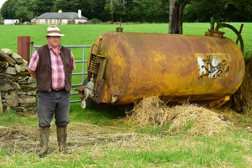 Tom Stephenson farmer placed a slurry tanker in gate way to stop removal of bales of straw from field. Photo Roger Jones.