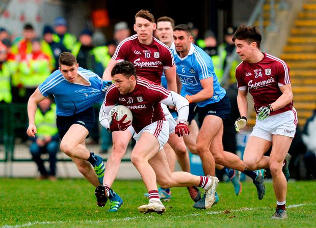 Galway need to get quick ball into Damien Comer – here being chased by Dublin's Emmet O'Conghaile (left) and James McCarthy in the NFL clash – if they want to win on Saturday, according to Joe Kernan. Photo: Ray Ryan/Sportsfile