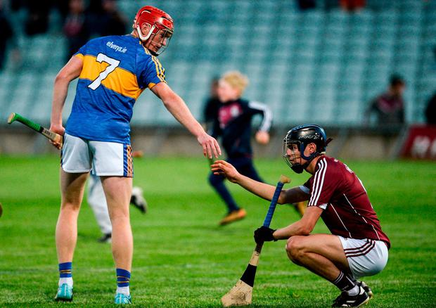 Tipperary's Dillon Quirke exchanges a handshake with Seán Loftus of Galway at the end of the game. Photo: Diarmuid Greene/Sportsfile