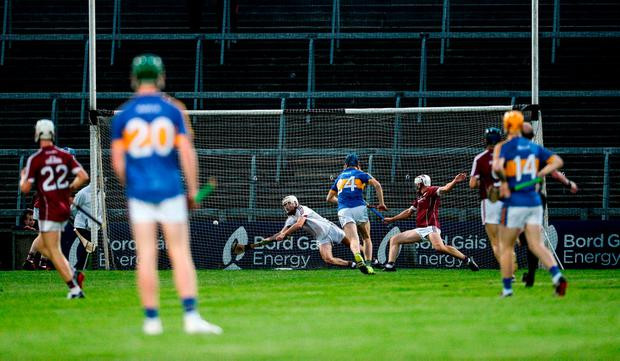 Ger Browne scores Tipperary's third goal despite the efforts of Galway's Darragh Gilligan. Photo: Diarmuid Greene/Sportsfile