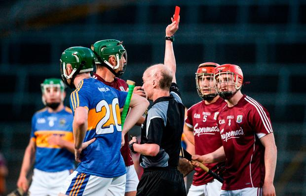 Cian Salmon of Galway is shown a straight red card by referee Sean Cleere. Photo: Diarmuid Greene/Sportsfile