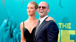 Rosie Huntington-Whiteley (L) and Jason Statham attend Warner Bros. Pictures And Gravity Pictures' Premiere of 'The Meg' at TCL Chinese Theatre IMAX on August 6, 2018 in Hollywood, California. (Photo by Christopher Polk/Getty Images)