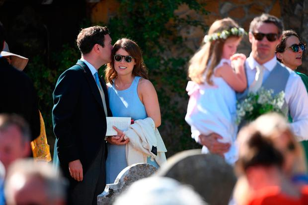 Princess Eugenie and her fiance Jack Brooksbank outside St Mary the Virgin Church in Frensham, Surrey, after attending the wedding of Charlie van Straubenzee and Daisy Jenks